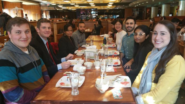 ystem Medicine students eating lunch together after visiting the NIH Sequencing Facility.