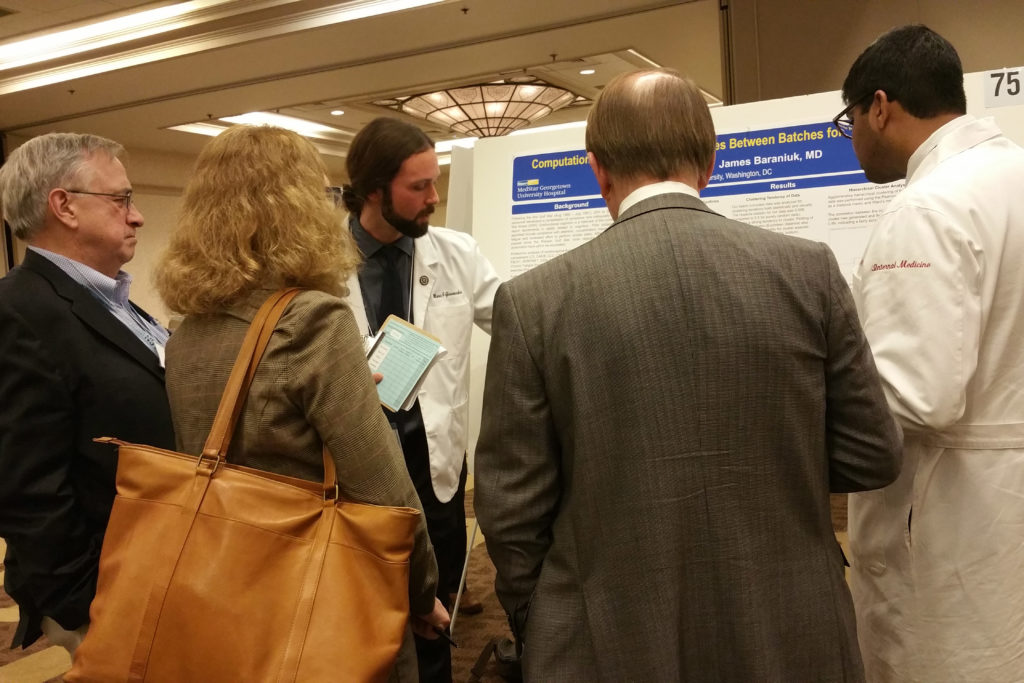 Mario Giovacchini, a System Medicine MD/MS Dual-Degree Program student, presents his research at a poster presentation.